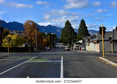Queenstown, New Zealand - May 4 2020: Looking South on Stanley Street Across the Shotover Street Intersection in downtown Queenstown, New Zealand during the Covid19 / Coronavirus Lockdown