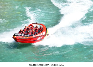 QUEENSTOWN, NEW ZEALAND - November 18: Tourists enjoy a high-speed boat ride on Queenstown's Shotover river on November 18, 2014 in Queenstown, New Zealand.