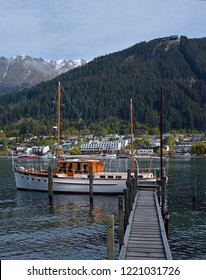 Queenstown, New Zealand - October 12, 2018;  Town & Lake Wakatipu Harbour & Boats in Spring.