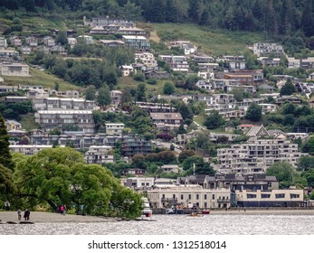 QUEENSTOWN, NEW ZEALAND/DECEMBER 13, 2018: Lakeside and mountainside vantage points abound for tourists and locals alike in this popular resort town on the South Island of New Zealand.