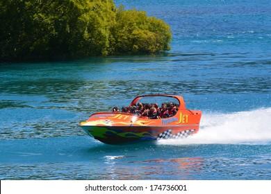 QUEENSTOWN, NZ - JAN 15:Tourists enjoy a high speed jet boat ride on Jan 15 2014 in Queenstown, New Zealand. Queenstown is one of the most popular summer and winter resort in NZ.