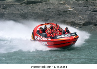 QUEENSTOWN, NZ - JAN 16:Tourists enjoy a high speed jet boat ride on the Shotover River on Jan 16 2014 in Queenstown, New Zealand. Queenstown is one of the most popular summer and winter resort in NZ.