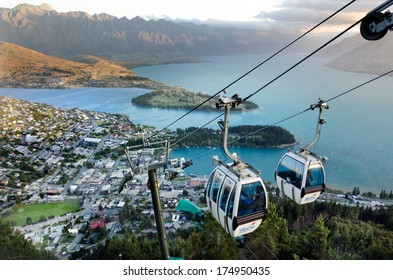 QUEENSTOWN, NZ - JAN 17 2014:Queenstown Skyline Gondola during sunset.It's the steepest cable car lift in the Southern Hemisphere, and one of the must-do activities in Queenstown, New Zealand.