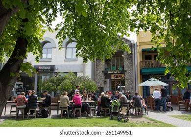 QUEENSTOWN, NZ - NOV 23 : Cafe in Queenstown city center on Nov 23, 2014. Crowded area full with tourists during lunch time in Queenstown, NZ.