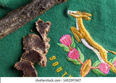 QUEENSTOWN, SOUTH AFRICA - 16 JULY 2019 -South African Springbok rugby jersey circa 1995 World Cup with slices of venison biltong, typical South African snack especially when watching the game