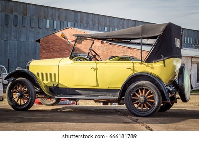 QUEENSTOWN, SOUTH AFRICA - 17 June 2017: Vintage Yellow Studebaker Commander car with wooden wheels parked at show