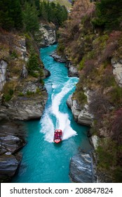 QUEENSTOWN,NZ - JULY 24: Tourists enjoying a high speed jet boat ride on the Shotover River on July 24, 2014 in Queenstown, New Zealand. Queenstown is a popular spot to spend the winter in NZ.
