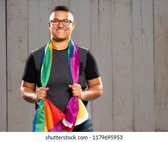 Queer black person with their pride flag