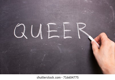 QUEER word chalk on a blackboard, symbol LGBT