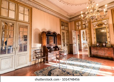 Queluz, Portugal - December 9, 2017: Antique wooden writing desk Inside of rich decorated Queluz Royal Palace. Formerly used as the Summer residence by the Portuguese royal family.