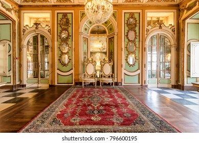 Queluz, Portugal - December 9, 2017: Ambassador's room Inside of rich decorated Queluz Royal Palace. Formerly used as the Summer residence by the Portuguese royal family.