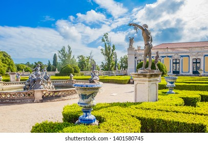 Queluz, Portugal - July 15, 2018: The National Palace of Queluz - Lisbon - Portugal. Fragment of Neptunes Fountain and the Ceremonial Facade of the Corps de Logis designed by Oliveira