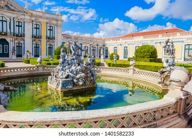 Queluz, Portugal - July 15, 2018: The National Palace of Queluz - Lisbon - Portugal. Neptunes Fountain and the Ceremonial Facade of the Corps de Logis designed by Oliveira