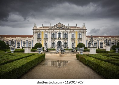QUELUZ, SINTRA / PORTUGAL - March 6th 2018: Facade and gardens of Queluz Palace in Sintra, Portugal, in a cloudy winter day.