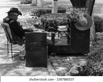 Queretaro / Mexico - Apr 2017 Shoeshiner or boot polisher is an occupation in which a person cleans and buffs shoes and then applies a waxy paste to give a shiny appearance and a protective coating