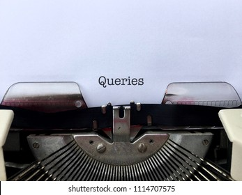 Queries, heading title typed in black ink on white paper on vintage manual typewriter machine