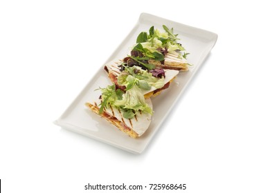 quesadilla with bacon and salad on a white background