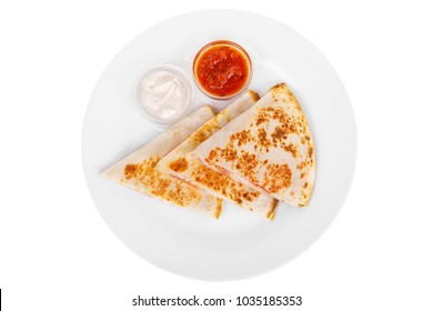 Quesadilla with chicken and tomatoes, two sauces from tomatoes and sour cream. isolated white. View from above