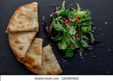 Quesadilla on a black slate background