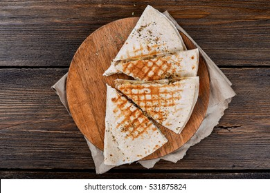 Quesadilla on a wooden table close-up shot