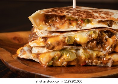 Quesadillas and chips on wooden tray