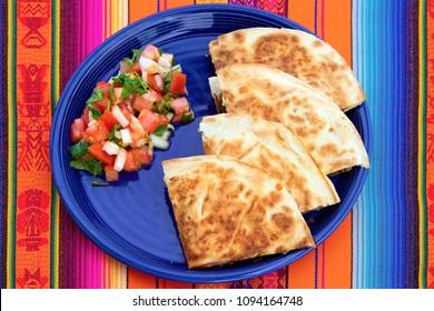 Quesadillas with fresh Pico de Gallo in Mexican restaurant