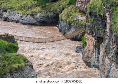 Queshuachaca (Q'eswachaka) rope bridge, one of the last standing Incan handwoven bridges, Quehue, Canas Province, Peru