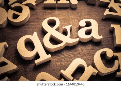 Question and Answer, q and a by wood letters on wood background