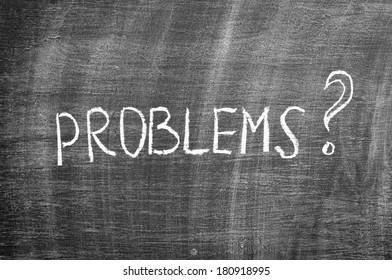question PROBLEMS? - handwritten with chalk on a blackboard