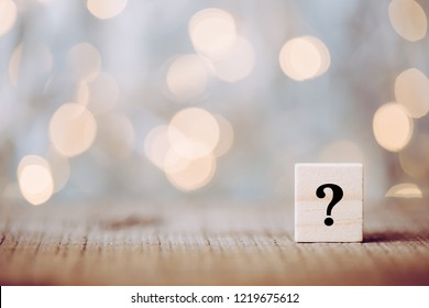 Question mark block with bokeh shining background.