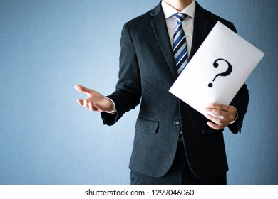 Question mark and businessman