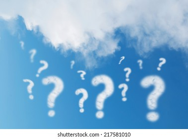 Question mark cloud on blue sky