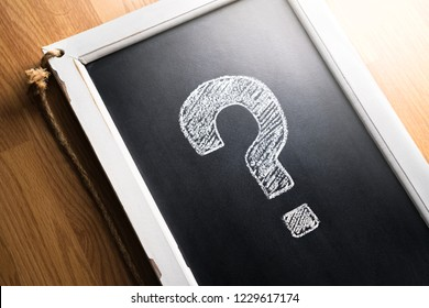 Question mark drawn on chalkboard.  About us, help or info for business. Survey, poll or quiz concept. Punctuation, decision, feedback or education. Frequently asked questions, FAQ or Q&A.