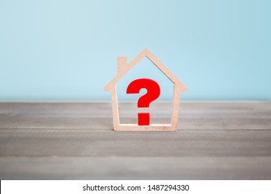 Question mark with house on wood table , Problem Concept