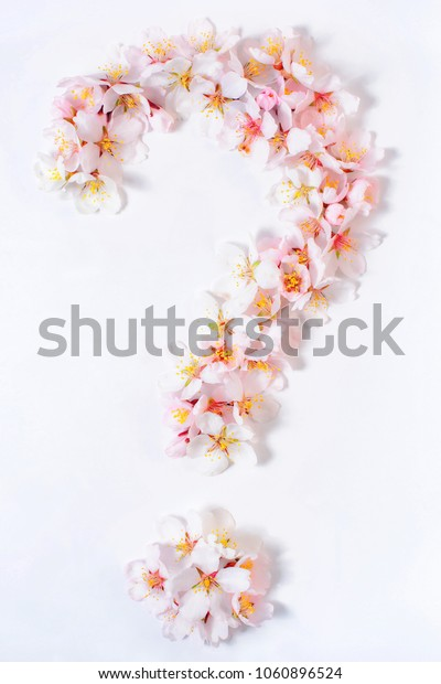Question mark lined with pink flowers on a white background