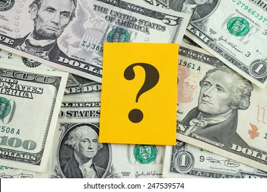 Question mark on dollar banknotes.