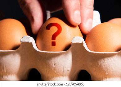 The question mark on the egg shell is the concept of finding a new solution and idea. The photo may illustrate product quality publications.