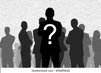 Question mark on silhouette businessman standing in front of colleagues against wall