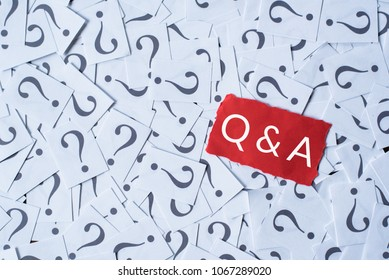 question mark on white paper and Q&A on red paper. questions and answer concept