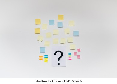 Question mark and post it on white background.