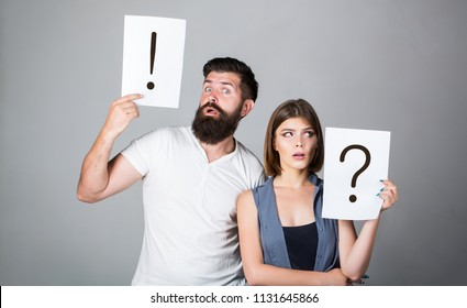 Question mark. Quarrel between two people. Pensive man and a thoughtful woman. Husband and wife not talking, being in quarrel. A woman and a man a question, exclamation point. Couple in quarrel.