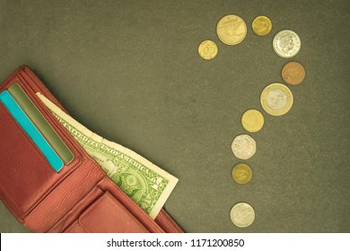 Question mark of small coins, near a purse with one dollar. Financial problems, increased costs, taxes. Shortage of cash.