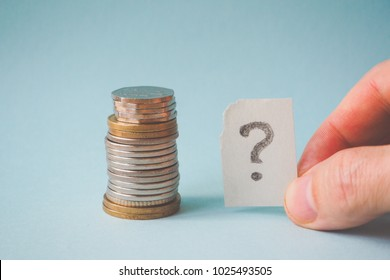 A question mark and a stack of coins.