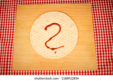 Question marke on a pizza to be topped at home
