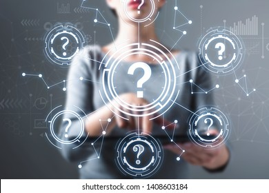 Question marks with business woman using a tablet computer