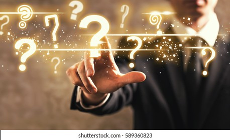 Question Marks with businessman on dark vintage background