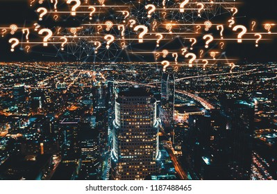 Question Marks with Downtown Los Angeles at night