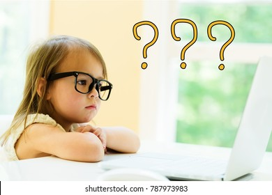 Question Marks with little girl using her laptop