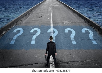 Question marks message on road and business man