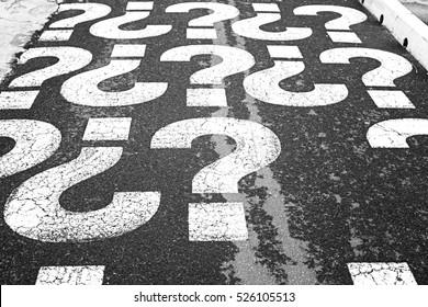 Question marks on urban street, symbol